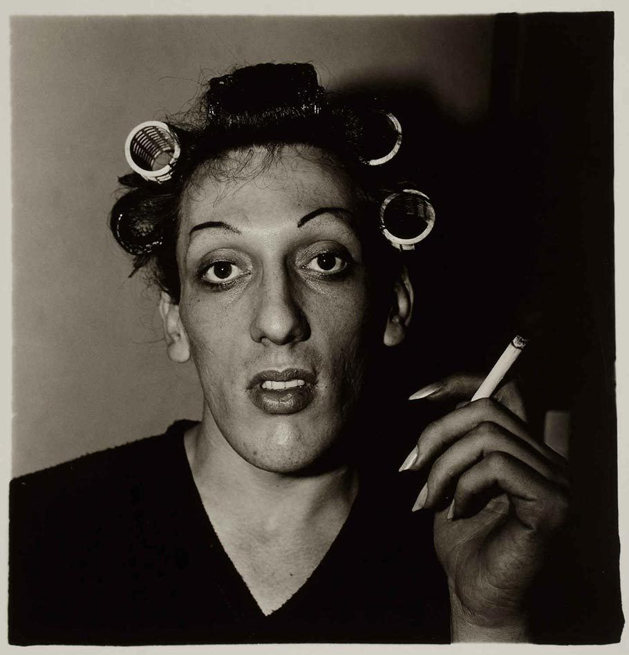 A young man in curlers dressing up for an annual dragball on West 20th Street, N.Y.C (1966) - Photo Diane Arbus