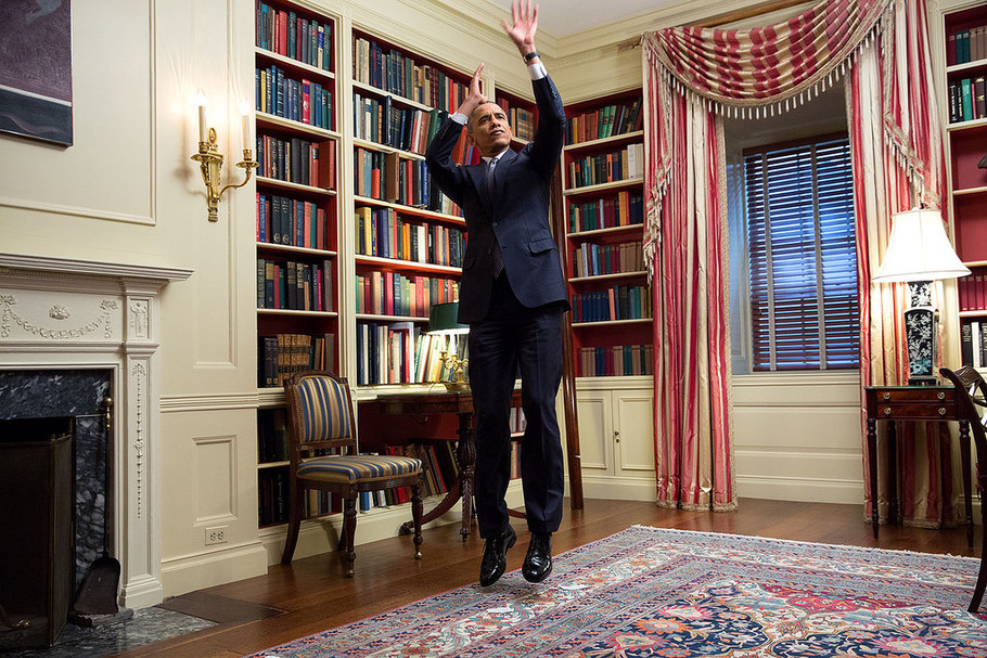 President Barack Obama feigns a jump shot during an Affordable Care Act video taping for BuzzFeed in the White House Library, Feb. 10, 2015. Official White House Photo by Amanda Lucidon